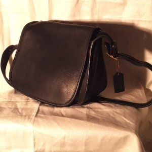 Black leather Coach purse with Coach tag